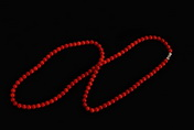A STRAND OF RED CORAL NECKLACE