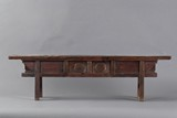 A carved hardwood bench