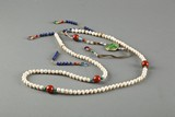 A strand of 108 pearl court beads