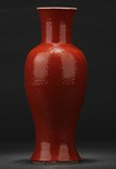 A RED GLAZED BALUSTER VASE