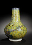 A YELLOW GLAZED 'MAGPIE' BOTTLE VASE