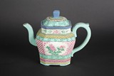 A ZISHA STONEWARE TEAPOT WITH COLOR