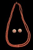 A TWO-STRAND RED CORAL BEAD NECKLACE AND A PAIR OF 14K CORAL EARRINGS