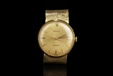 A VINTAGE ROLEX PRECISION 18K GOLD WATCH WITH 18K YELLOW GOLD BAND