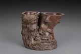 AN IRONWOOD ROOT DOUBLE BRUSH POT