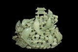 A LARGE CARVED JADE 'SCHOOL OF FISH' FIGURAL GROUP