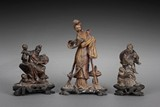 A GROUP OF THREE QINGTIAN SOAPSTONE CARVINGS OF PEOPLE