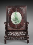 A CARVED HONGMU SCREEN INSET WITH JADEITE PLAQUE
