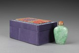 A JADEITE SNUFF BOTTLE WITH BOX