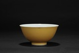 A SMALL YELLOW GLAZED BOWL
