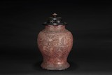 A CARVED LACQUER BALUSTER JAR WITH COVER
