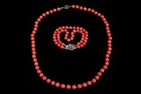 A RED CORAL BEAD NECKLACE AND TWO-STRAND BRACELET
