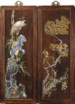 A PAIR OF DECORATED AND GILT WOOD HANGING PANELS