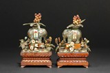 A PAIR OF CLOISONNE ENAMEL ELEPHANTS WITH WALNUT WOOD STAND AND GEM DECORATIONS