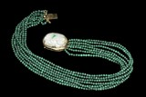 A MALACHITE NECKLACE WITH JADE PENDANT AND 14K YELLOW GOLD