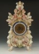 AN EUROPEAN PORCELAIN FIGURAL AND MYTHICAL BEAST CLOCK