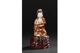 A GILT AND PAINTED MARBLE GUANYIN FIGURE