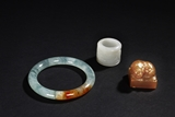 A SHOUSHAN STONE SEAL, A JADEITE BANGLE, AND A WHITE JADE ARCHER'S THUMB RING