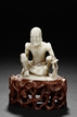A SOAPSTONE CARVED FIGURE OF ASCETIC SHAKYAMUNI