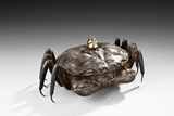 A SILVER AND METAL 'CRAB' CONTAINER WITH LID