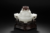 A WHITE JADE TRIPOD CENSER WITH WOODEN FINIAL AND STAND