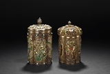 A PAIR OF SILVER FILIGREE AND ORNATED BOXES WITH COVERS