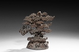 A BRONZE CAST PINE TREE GROUP