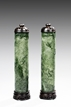 A PAIR OF OPENWORK SPINACH JADE SMOKE CYLINDERS