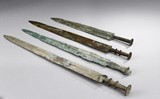 A GROUP OF FOUR ARCHAIC BRONZE SWORDS