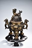 A LARGE GILT-BRONZE #MYTHICAL BEAST# TRIPOD CENSER