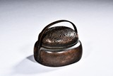 A SMALL BRONZE HANDWARMER