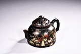 A YIXING GILTED DECORATED TEAPOT