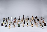 A GROUP OF VINTAGE SMALL WINE/LIQUOR BOTTLES