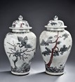 A PAIR OF BLUE AND WHITE JARS WITH COVER