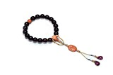 A 'GOLDEN LINE' CHERRY AMBER CORAL ROSARY BRACELET