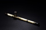 A SILVER AND BONE CARVED OPIUM PIPE