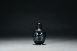A BLACK LACQUERED MOTHER-OF-PEARL SNUFF BOTTLE