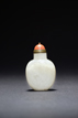 A WHITE JADE CHILONG MOTIF SNUFF BOTTLE