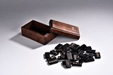 A SET OF CHINESE BLACK TILES WITH WOOD BOX