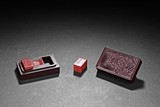 A SET OF RED SHOUSHAN SEALS AND BOX