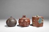 A SET OF THREE YIXING TEAPOTS
