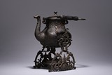 A BRONZE OR SILVER-PLATE 'GOOSE' TEAPOT