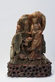 A LARGE SOAPSTONE GUANYIN FIGURAL CARVING WITH INSCRIPTION