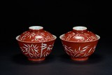 A PAIR OF CORAL RED RESERVE-DECORATED BOWLS