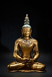 AN IMPRESSIVE GILT-BRONZE FIGURE OF AMITAYUS