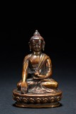 A SMALL BRONZE FIGURE OF SEATED SHAKYAMUNI
