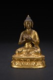 A GILT-BRONZE FIGURE OF SHAKYAMUNI