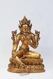 A GILT-BRONZE FIGURE OF TARA
