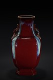 A LARGE RED FLAMBE-GLAZED VASE