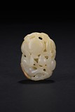 A WHITE JADE CARVING OF MONKEY AND PEACH